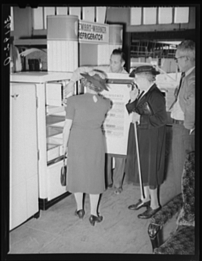 11. Having an electric refrigerator was a big deal and new enough that this salesman showed some consumers how it operates.