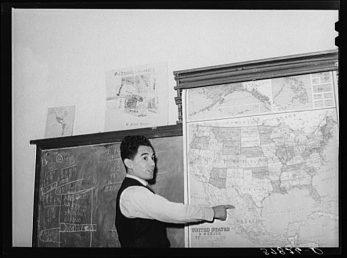 13. This teacher is in the middle of a geography lesson at a grade school in Concho.