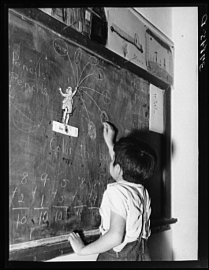 14. This student is completing some kind of activity at the chalkboard in a Concho school.