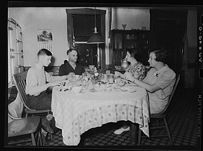 8. The Royer family eats supper in their kitchen, 1938. The family lived in Lancaster county and ran the Enos Royer farm.