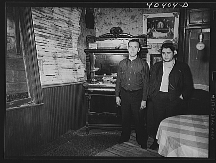 13. Two men stand in the dining room of a house in Gilberton, 1938.