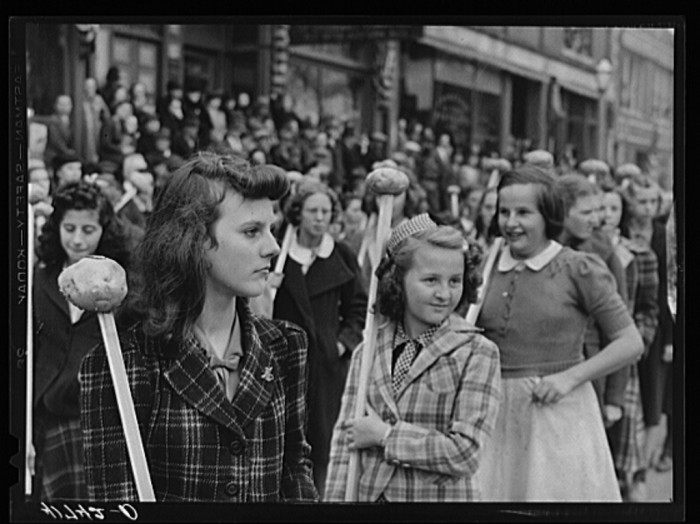 7. These schoolgirls attended with Aroostook potatoes on sticks as part of the parade on the day of the barrel rolling contest.