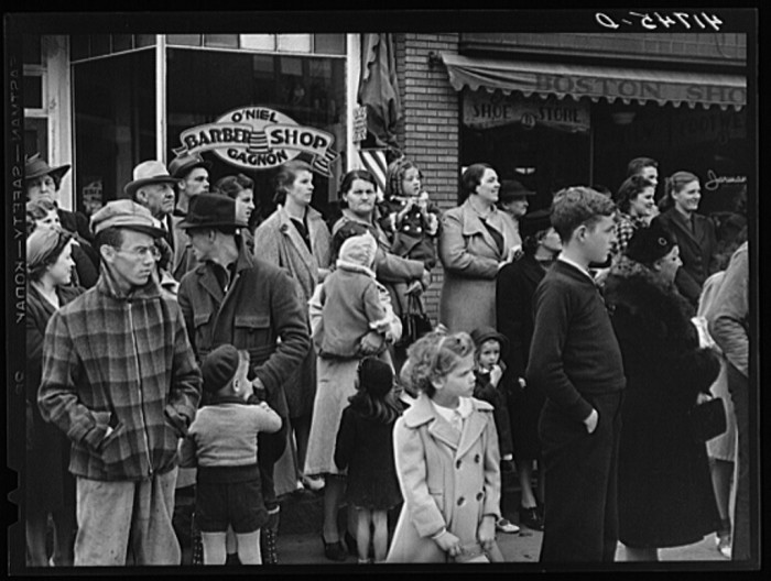 6. Spectators await the excitement outside of the O'Niel Gagnon Barber Shop.