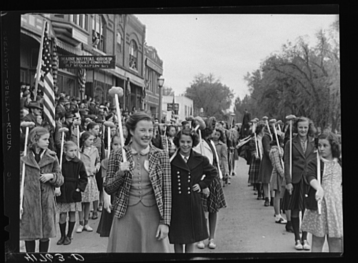 8. Schoolgirls with potatoes are pleased as punch to be involved in the parade.