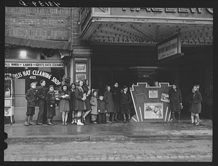 12. Some children wait in line at the movies in Pittsburgh on a Sunday afternoon, 1941.