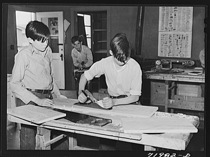21. After classroom studies, some of the boys participate in a vocational workshop.