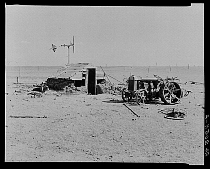 """10.  """"Idle tractor and machine shed on farm in drought-stricken Williams County, North Dakota"""""""
