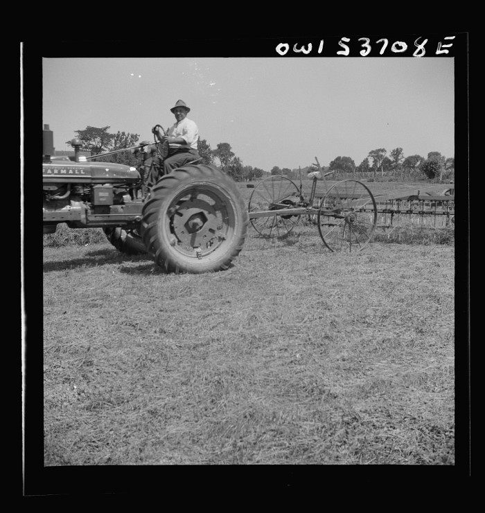 9. A tractor at Spring Run Farm in Dresher rakes hay into rows.