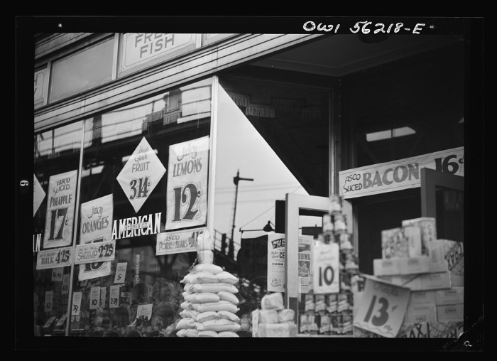 7. A grocery store on Philadelphia's Market Street West advertises its wares, 1939.