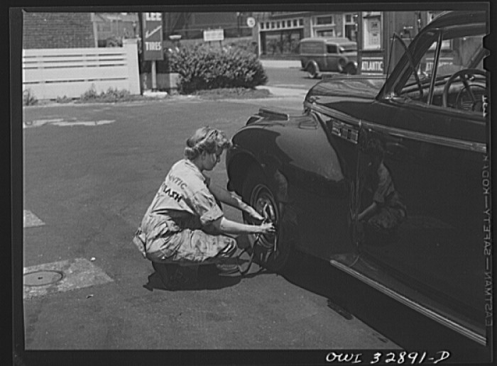 2. Miss Natalie O'Donald, a garage attendant, works on a car at Philadelphia's Atlantic Refining Company (which later was acquired by Sonoco).