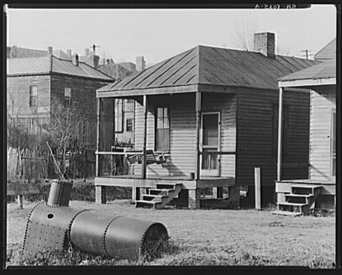 9. Lining a Vicksburg street, these small homes were the norm for many.
