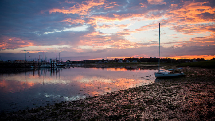 15. The setting sun casts a subtle pink light on the glassy waters of Wellfleet Harbor.