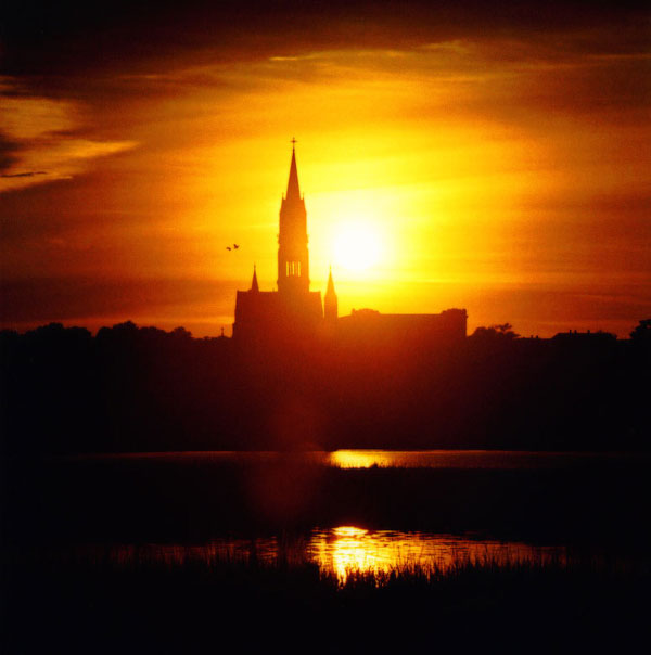 12. The brilliant sun behind a church in New Bedford.