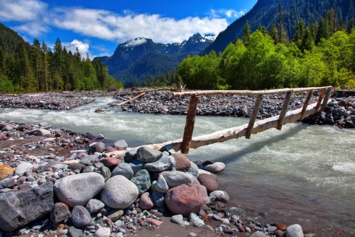 12. An adventurous scene captured by the Carbon River Footbridge in Mount Rainier National Park.
