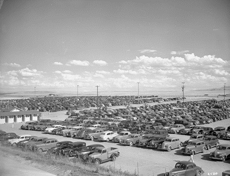"12. ""Denver Ordnance Plant, parked cars."""