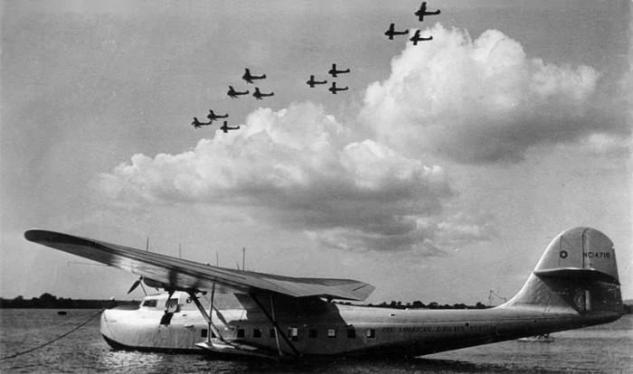 2) A Pan American Airways M-130 sits at Pearl Harbor.