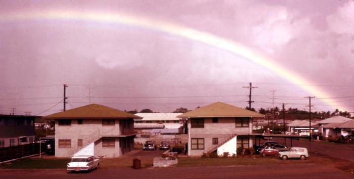 6) A rainbow appears over a residential neighborhood in Waipahu.