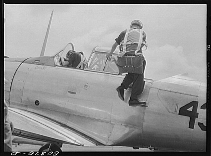 13. A cadet is mounting the plane prior to his training flight. Craig Field, Southeastern Air Training Center, Selma - August 1941.