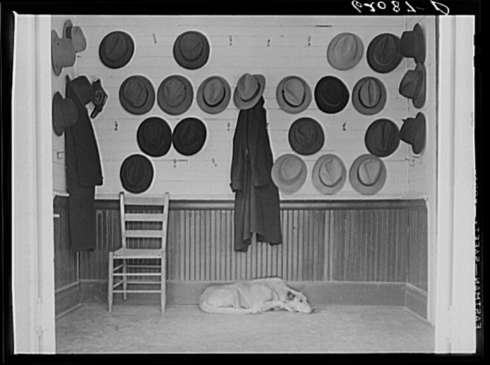 3. Vestibule of Baptist church during Sunday services in Gadsden. The hats belong to steel and cotton mill workers - December 1940.
