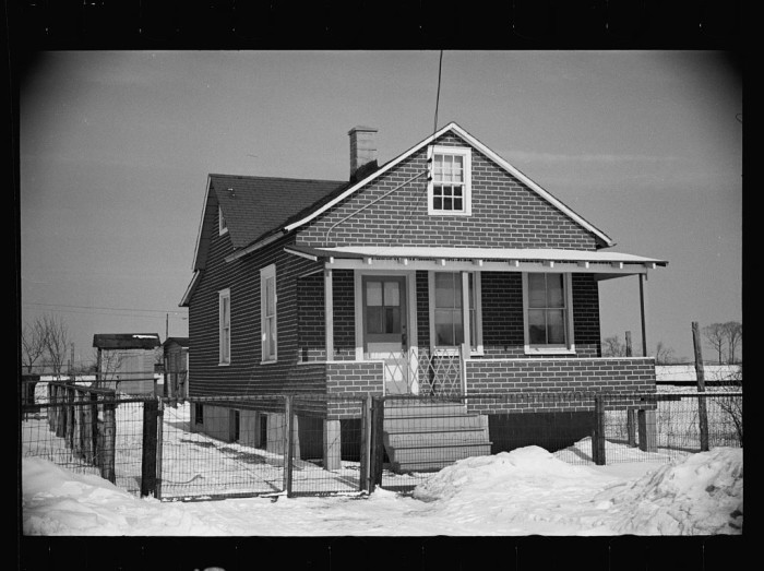 9. Though this home appears to be brick, it is actually a tarpaper-covered wooden house, typical of homes in the New Brunswick-area neighborhood.