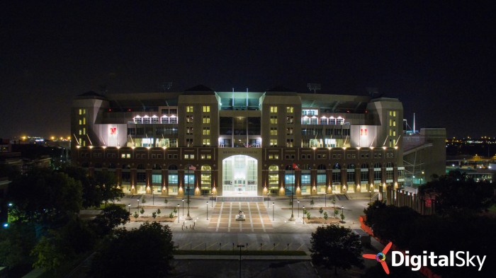 10. Memorial Stadium is all lit up at night.