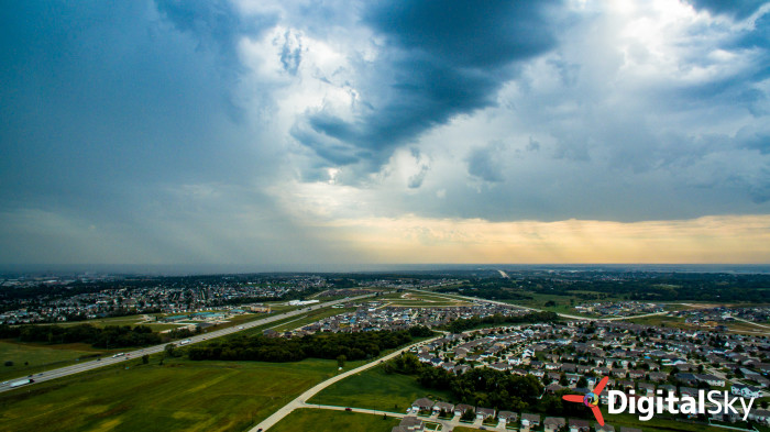 23. Looking toward the south, storm clouds move in toward the city.
