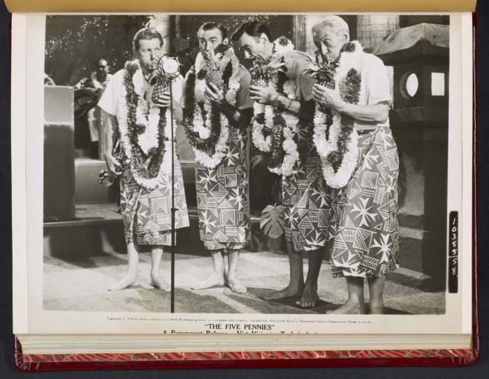 8) Danny Kaye as photographed onstage with male actors in Hawaiian attire.