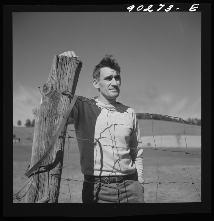 7. Floyd Fleming looks out over the farm that houses him and his family just outside of Radford, 1941.