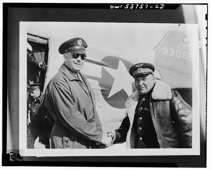 5. Alaskan Commander and Russian Commander shaking hands at the Nome air base, 1943.