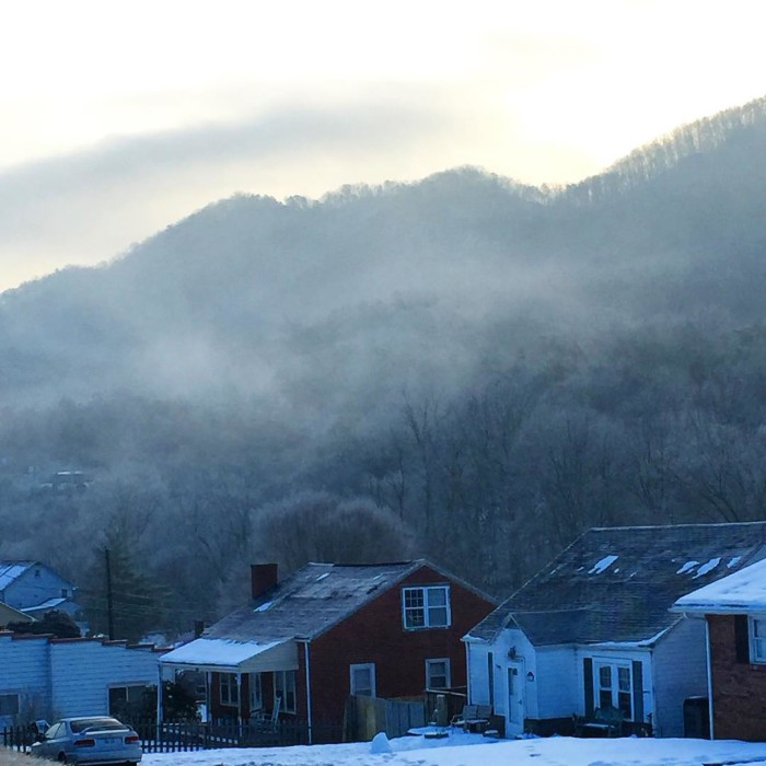 3. A misty mountain town in Gate City.