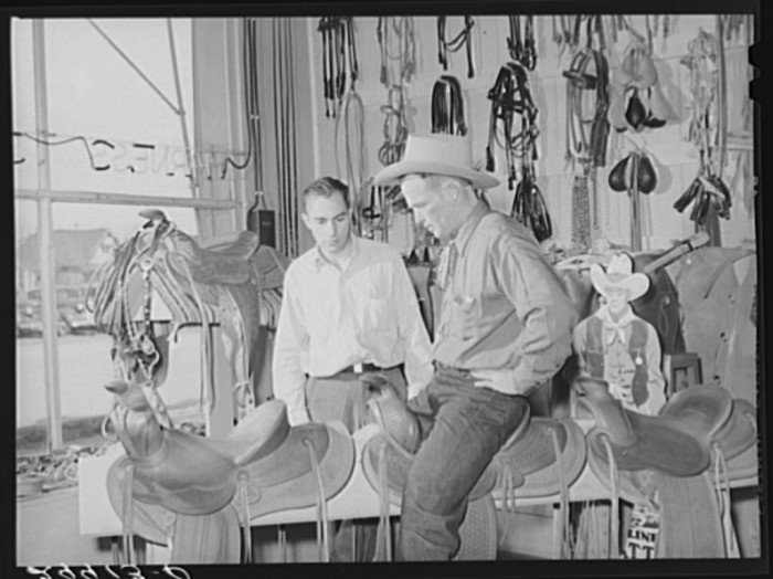 11. A cowhand trying out his saddle at Capriola Saddlery in Elko, Nevada.