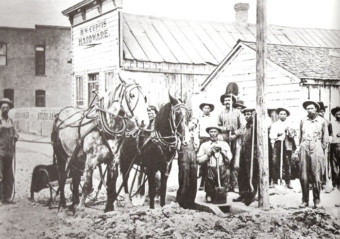 17. Idaho man-power: early settlers plowing the road for Main Street, 1906