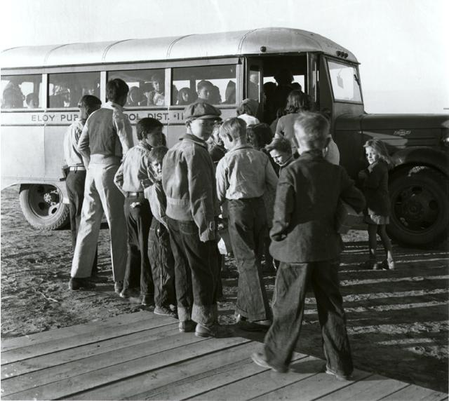 17. Kids waiting at the bus stop.