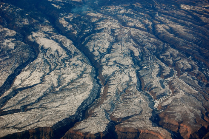 5. Unknown: Snow outlines New Mexico's rocky landscape.