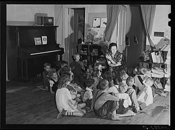 2) Teacher telling story to migrant children in nursery school run by Women's Council for Home Missions, Berrien County, July 1940.
