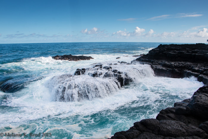 13) Waves rush over the rocks at the queen's bath, a popular swimming hole when the waves are calm.