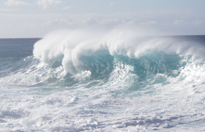14) A wicked curl at Oahu's Kaena Point.
