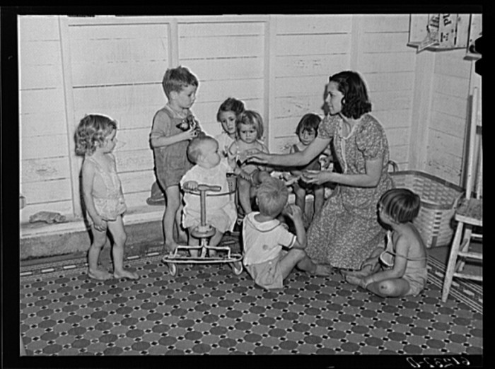 1) Young children are taken to nursery school operated by Women's Council for Home Missions while parents are picking fruit, Berrien County.