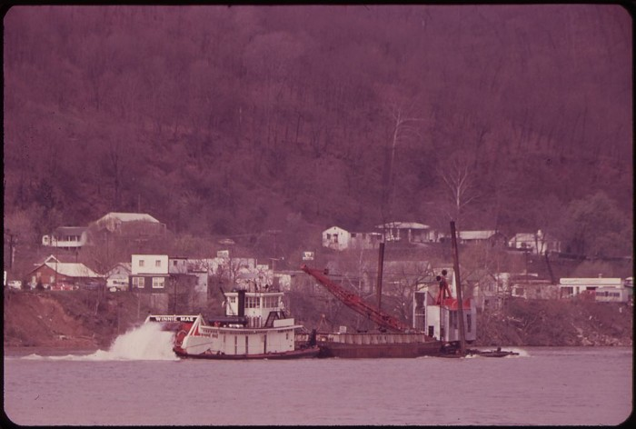 19. A boat passes a barge on the Kanawha River in 1973.
