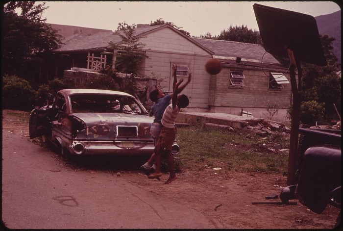 14. Kids play a basketball game on Church Avenue in Rand (1973).