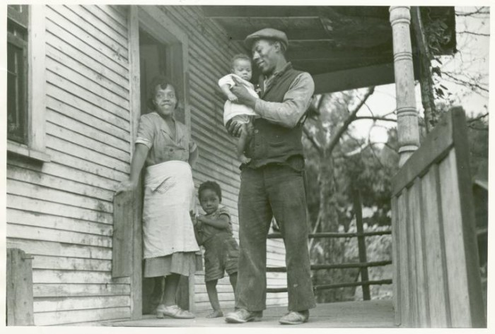 2. Here's a family from Bertha Hill (Monongalia County) standing on the porch of their home in 1938. The man was a coal miner.
