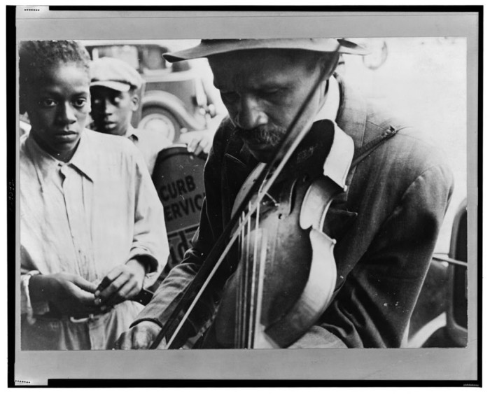 4. Blind Street Musician