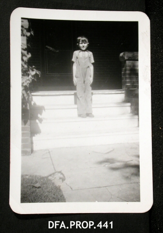 "10.)""Young Boy Standing on Porch Steps."""
