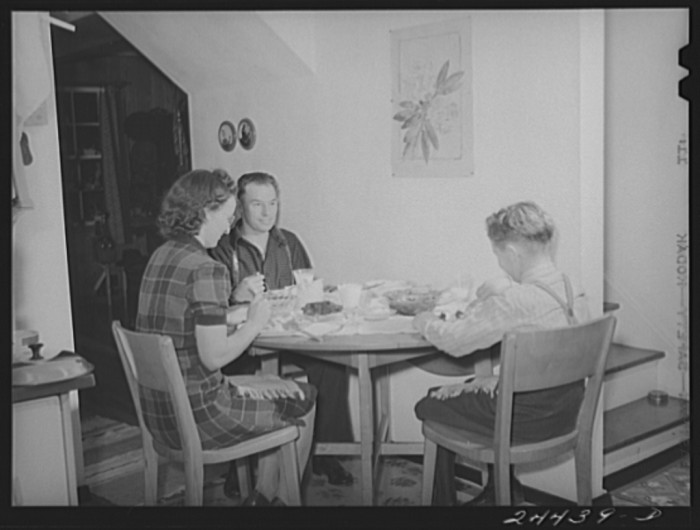 1. This family, the Hardemans, share an evening meal in Dailey in 1941.