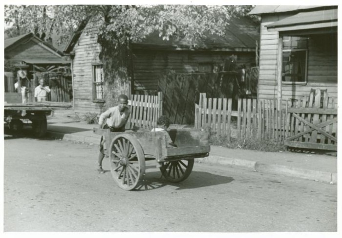 """1. This man was pushing a wagon in the """"black"""" part of Charleston, 1939."""