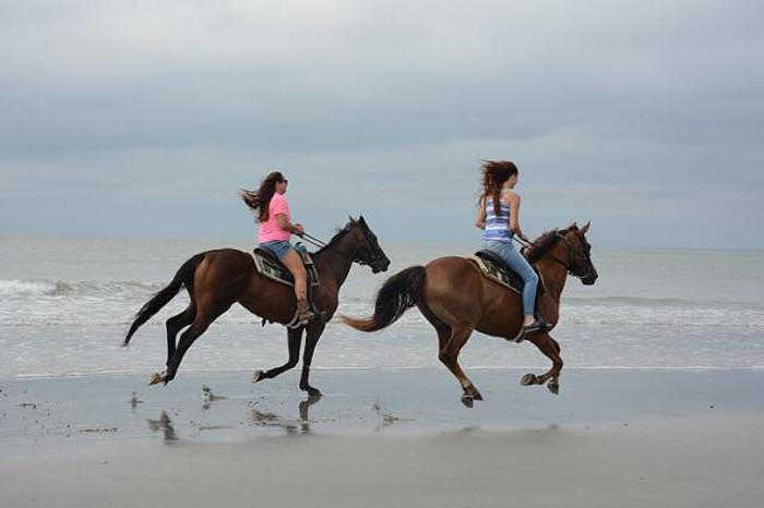 9. Go horseback riding - on the beach!