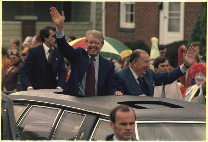 20. Former president Jimmy Carter and U.S. Sen. Jennings Randolph  wave from a motorcade in Elkins in 1978.