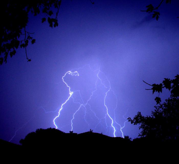 10. Lightning illuminates the Clovis night.