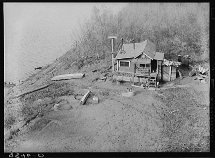 20. A shack, likely built from scrounged materials, sits dangerously close to the bank of the Missouri River in Omaha.