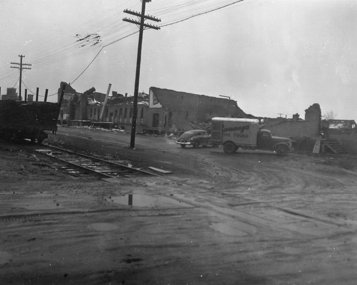 12. View of damage to a wholesale grocery warehouse on the east edge of the tornado damaged path.